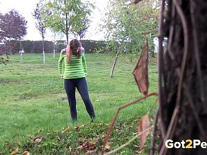 Amateur Brunette Stands And Pees Over The Grass